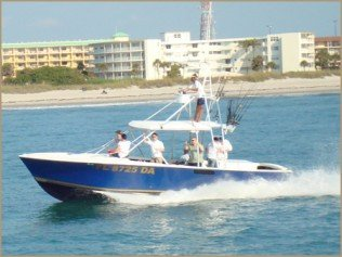 Ofishal Business Charters Nearshore fishing trip boat driving